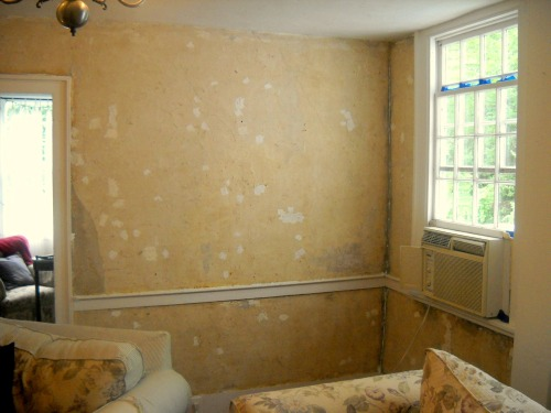 Wallpaper removed, with spackle.